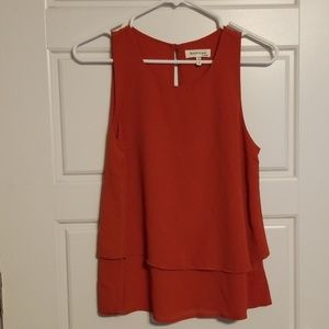 Sleeveless dark orange top